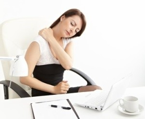 The Uncomfortable Truth About Sitting All Day, Back and Neck Pain can Result. Why adjustable tables help - AdjustableSurfaces.com